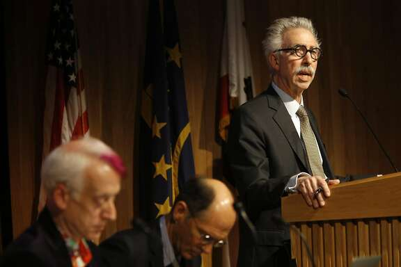 ( l to r) Andrew Garrett, senate parliamentarian, Robert Powell, senate chair as UC Berkeley chancellor Nicolas Dirks, (right) speaks to the faculty senate during a meeting at UC Berkley on Tues. May 3, 2016, in Berkeley, California.