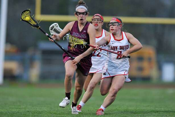 Margaret Roberts of Burnt Hills, left, tries to get past Hayley Kmack of Guilderland during their game on Tuesday, May 3, 2016, in Guilderland, N.Y.  (Paul Buckowski / Times Union)