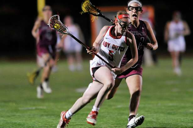 Kerry Gerety of Guilderland races the ball up the field during their game against Burnt Hills on Tuesday, May 3, 2016, in Guilderland, N.Y.  (Paul Buckowski / Times Union)
