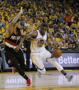 Ian Clark (21) drives to the basket against Allen Crabbe (4) in the first half as the Golden State Warriors played the Portland Trail Blazers in Game 2 of the second round of the Western Conference Playoffs at Oracle Arena in Oakland , Calif., on Monday, April 25, 2016., Calif., on Tuesday, May 3, 2016.