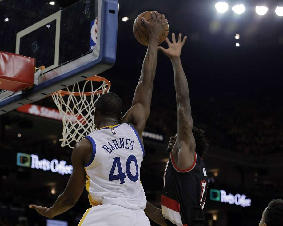 Harrison Barnes (40) dunks over Ed Davis (17) in the first half as the Golden State Warriors played the Portland Trail Blazers in Game 2 of the second round of the Western Conference Playoffs at Oracle Arena in Oakland , Calif., on Monday, April 25, 2016., Calif., on Tuesday, May 3, 2016. Photo: Carlos Avila Gonzalez, The Chronicle