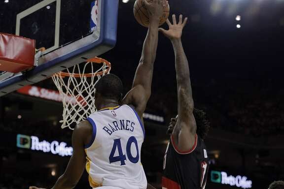 Harrison Barnes (40) dunks over Ed Davis (17) in the first half as the Golden State Warriors played the Portland Trail Blazers in Game 2 of the second round of the Western Conference Playoffs at Oracle Arena in Oakland , Calif., on Monday, April 25, 2016., Calif., on Tuesday, May 3, 2016.