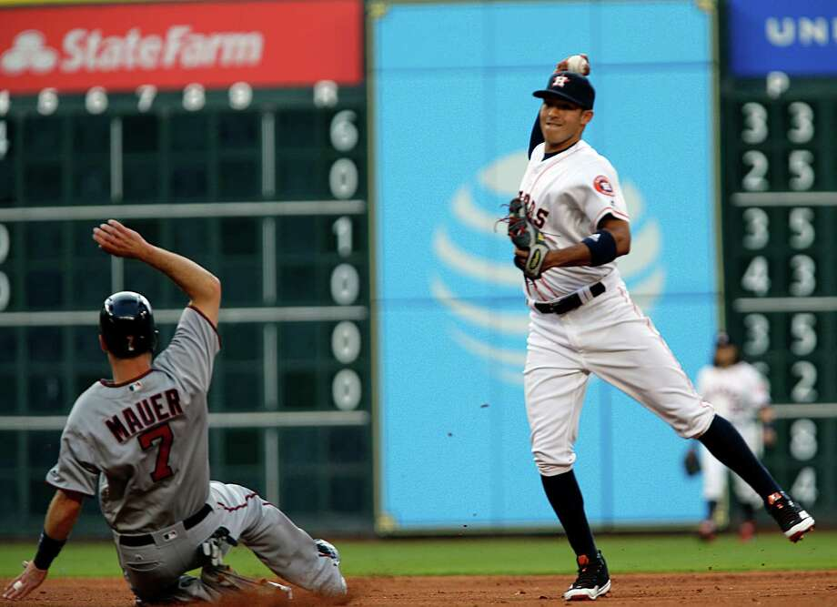 Houston Astros shortstop Carlos Correa right, fields the ball for a double play  during the second inning of MLB game action at Minute Maid Park Tuesday, May 3, 2016, in Houston.  ( James Nielsen / Houston Chronicle ) Photo: James Nielsen, Staff / © 2016  Houston Chronicle