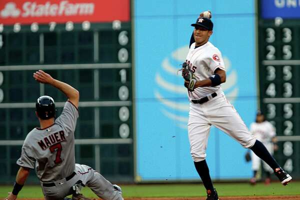 Houston Astros shortstop Carlos Correa right, fields the ball for a double play  during the second inning of MLB game action at Minute Maid Park Tuesday, May 3, 2016, in Houston.  ( James Nielsen / Houston Chronicle )