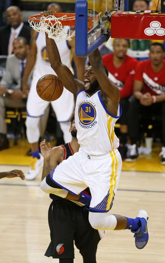 Golden State Warriors' Festus Ezeli dunks in 4th quarter against Portland Trail Blazers in Game 2 of NBA Playoffs' Western Conference Semifinals at Oracle Arena in Oakland, Calif.,, on Tuesday, May 3, 2016. Photo: Scott Strazzante, The Chronicle