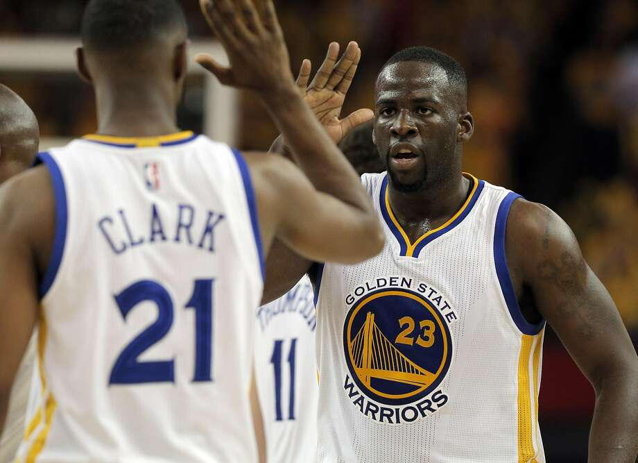Draymond Green (23) high fives Ian Clark (21) after Green was fouled on a shot in the first half as the Golden State Warriors played the Portland Trail Blazers in Game 2 of the second round of the Western Conference Playoffs at Oracle Arena in Oakland , Calif., on Monday, April 25, 2016., Calif., on Saturday, February 4, 2012. Photo: Carlos Avila Gonzalez, The Chronicle
