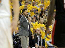 Stephen Curry (30) gives a teammate some instructions from the bench in the first half as the Golden State Warriors played the Portland Trail Blazers in Game 2 of the second round of the Western Conference Playoffs at Oracle Arena in Oakland , Calif., on Monday, April 25, 2016., Calif., on Tuesday, May 3, 2016.