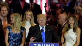 Republican presidential candidate Donald Trump is joined by his wife Melania, right, and daughter Ivanka, left, as he arrives for a primary night news conference, Tuesday, May 3, 2016, in New York.