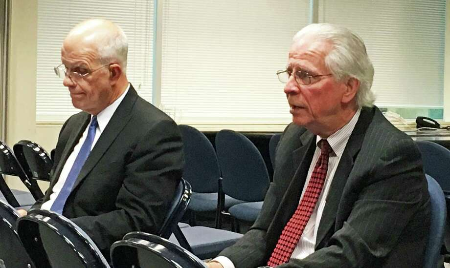 Consultants Brad Draeger, left, and Dwight Pfennig, from Hazard, Young, Attea & Associates, listen to resients about what they would like to see in a new superintendent of schools. Photo: Genevieve Reilly / Hearst Connecticut Media / Fairfield Citizen