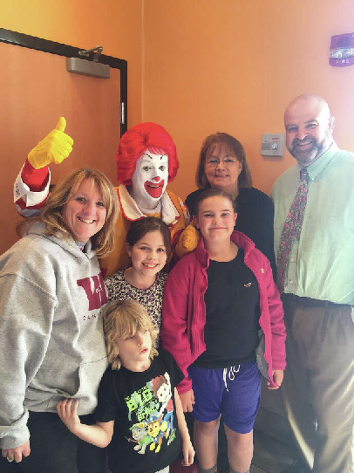 Ronald McDonald visits McTeacher?s Night held in April at the McDonald?s in Watervliet. Watervliet Elementary staff and teachers including PTA President Melanie Irvine, second-grade teacher Mary Sennett and Assistant Principal Dave Wareing ? seen with some friends ? worked at the restaurant to raise money for the school. Each restaurant donated 20 percent of proceeds to their local school. Schools in Albany, Waterford, Greenwich, Valatie, Wynantskill and Fultonville are participating. Last year, the program raised $19,650 for participating schools in the Capital Region.
