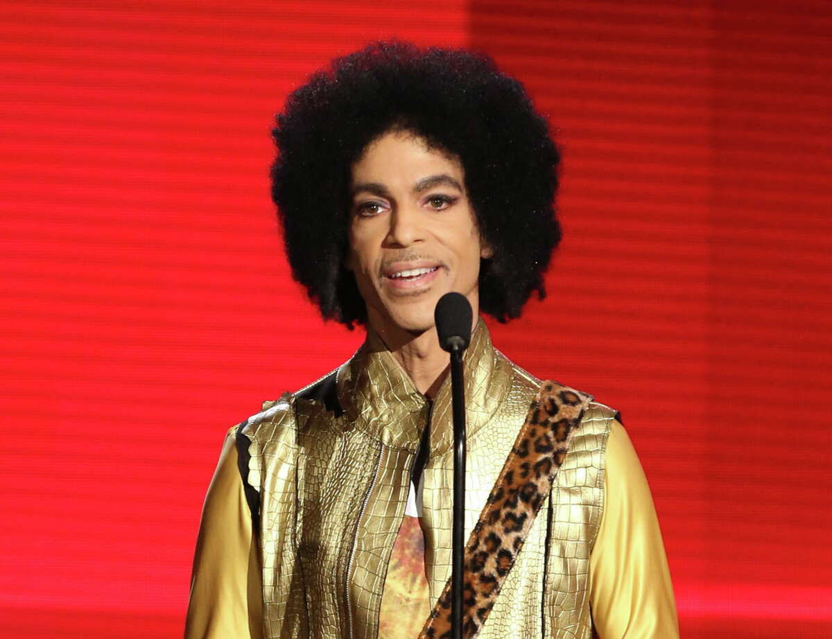 FILE - In this Nov. 22, 2015 file photo, Prince presents the award for favorite album - soul/R&B at the American Music Awards in Los Angeles. Mariah Brown, a former assistant to Prince until last year, has spent the days since his death trying to figure out how her boss, could have died so suddenly, adding that she never saw the singer ingest any substances during her employ. Prince was found dead at his home on April 21, 2016, in suburban Minneapolis. He was 57. (Photo by Matt Sayles/Invision/AP, File) ORG XMIT: NYET210