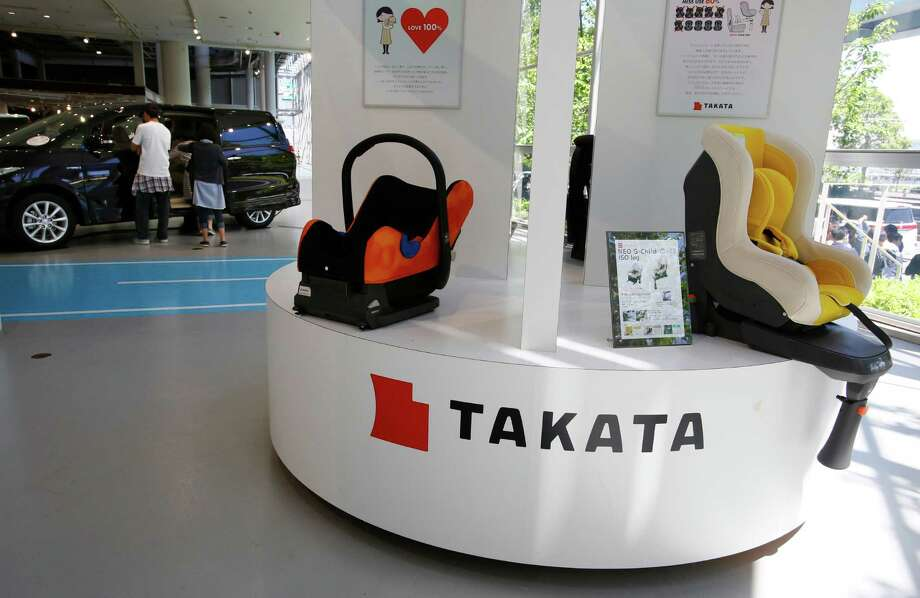 Visitors look at a Toyota's Estima near child seats, manufactured and displayed by Takata Corp. at an automaker's showroom in Tokyo. The National Highway Traffic Safety Administration announced Wednesday that 35 million to 40 million air bag inflators will be added to the recalls. Photo: Shizuo Kambayashi /Associated Press / Copyright 2016 The Associated Press. All rights reserved. This material may not be published, broadcast, rewritten or redistribu