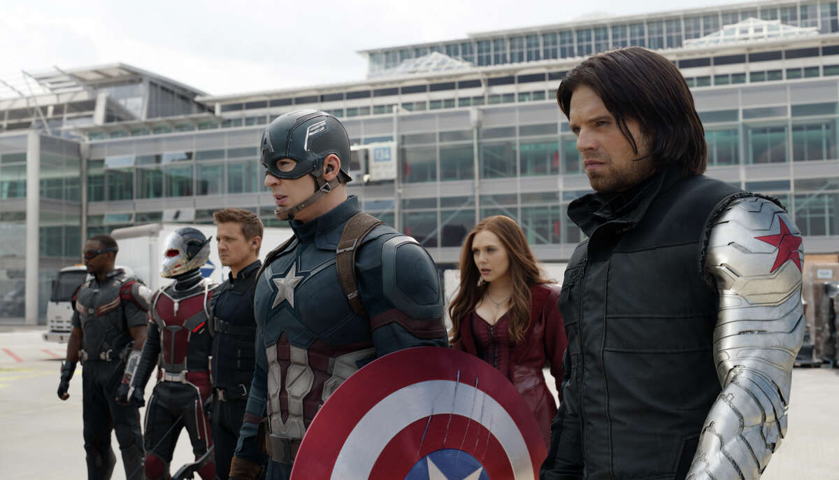 In this image released by Disney, Anthony Mackie, from left, Paul Rudd, Jeremy Renner, Chris Evans, Elizabeth Olsen and Sebastian Stan appear in a scene from