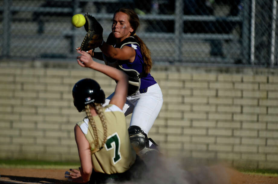 Legacy Christian Academy's Braily Smith slides safely into home against St. Joseph Catholic School's catcher Faith Starnes on Tuesday evening.  Photo taken Tuesday 5/3/16 Ryan Pelham/The Enterprise Photo: Ryan Pelham / ©2016 The Beaumont Enterprise/Ryan Pelham