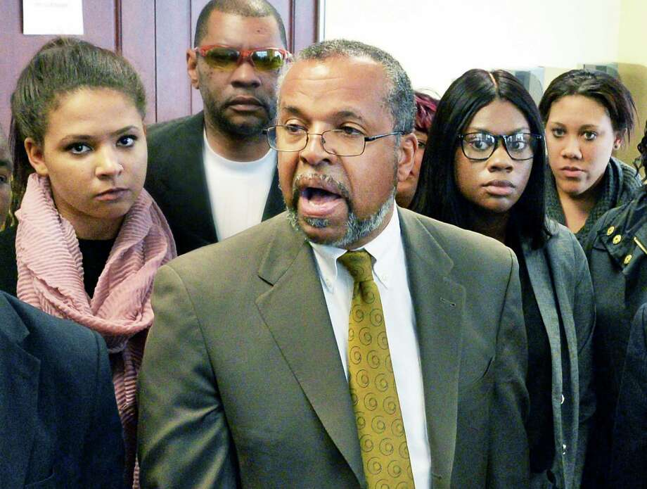 Attorney Frederick Brewington, center, speaks to reporters as the UAlbany students accused of a CTDA bus attack, Alexis Briggs, left, Asha Burwell and Ariel Agudio, right, leave Albany County Court following their arraignment Wednesday May 4, 2016 in Albany, NY.  (John Carl D'Annibale / Times Union) Photo: John Carl D'Annibale / 20036470A