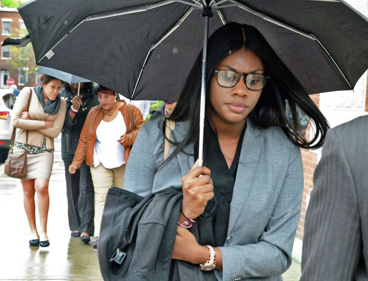 Two of the UAlbany students accused of a CTDA bus attack, Ariel Agudio, left, and Asha Burwell leave Albany County Court following their arraignment Wednesday May 4, 2016 in Albany, NY. (John Carl D'Annibale / Times Union)