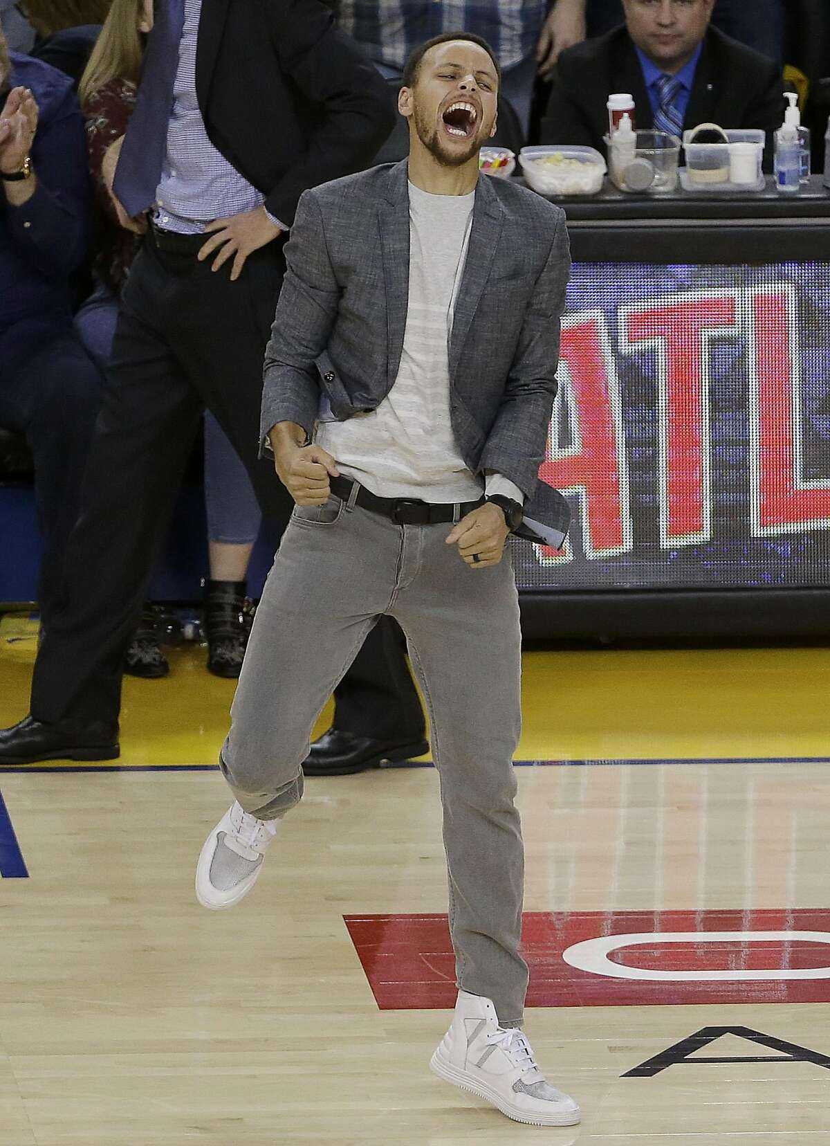 Golden State Warriors guard Stephen Curry celebrates during the second half in Game 2 of a second-round NBA basketball playoff series against the Portland Trail Blazers in Oakland, Calif., Tuesday, May 3, 2016. The Warriors won 110-99.