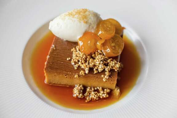 "NOTE: THESE ARE FOR THE 2015 TOP 100 RESTAURANTS GUIDE. DO NOT USE ONLINE OR IN PRINT BEFORE 9/24/2015. Caracol: Flan de Cafe de Olla (Clay-pot cinnamon coffee-orange custard with cré¨me fraéche and kumquats. Caracol's Flan de Cafe de Olla  clay pot cinnamon coffee-orange custard, crme fra""che, kumquats. Photographed, Friday, May 22, 2015, in Houston. ( Nick de la Torre /  )"