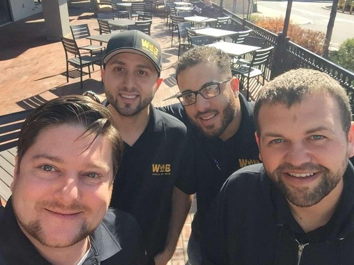 Matt Christy, Troy Livingston, Julian Garcia, Matt Sousa of World of Beer, which opened a new location in Milford.