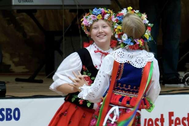 Olivia Kuligowski, left, and Eliza Masewicz perform during the Polish Festival at Our Lady of Czestochowa Catholic Church Saturday, Sept. 12, 2009.