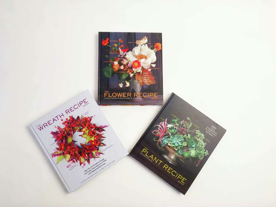 "Baylor Chapman's ""The Plant Recipe Book"" and Studio Choo's Althea Harampolis and Jill Rizzo's ""The Flower Recipe Book"" and ""The Wreath Recipe Book."" Photo: Emily Spicer /San Antonio Express-News"