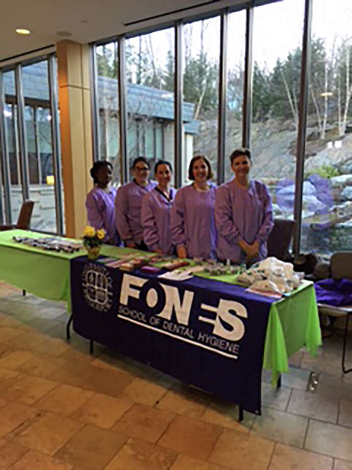 Students from University of Bridgeport, Fones School of Dental Hygiene assisted at the free oral, head and neck cancer screenings at the Center for Cancer Care at Griffin Hospital. Photo: Contributed / Contributed