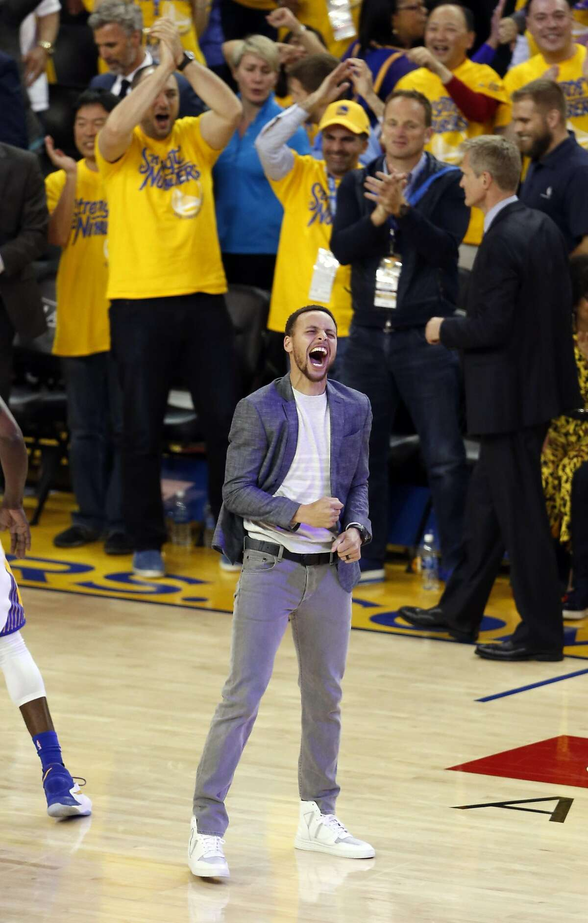 Golden State Warriors' Stephen Curry celebrates in 4th quarter against Portland Trail Blazers in Game 2 of NBA Playoffs' Western Conference Semifinals at Oracle Arena in Oakland, Calif.,, on Tuesday, May 3, 2016.