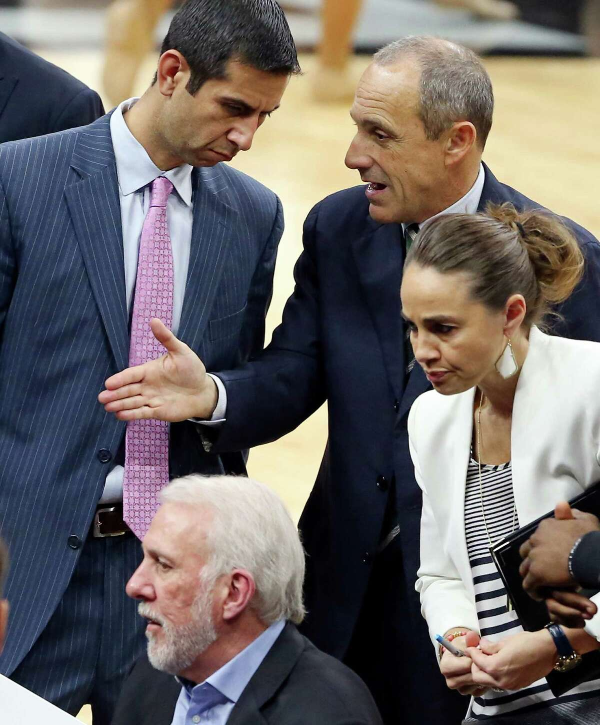 San Antonio Spurs assistant coaches James Borrego (from left clockwise) and Ettore Messina talk as assistant coach Becky Hammon listens to head coach Gregg Popovich talk with players during second half action against the Atlanta Hawks Saturday Nov. 28, 2015 at the AT&T Center. The Spurs won 108-88.