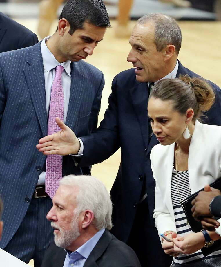 San Antonio Spurs assistant coaches James Borrego (from left clockwise) and Ettore Messina talk as assistant coach Becky Hammon listens to head coach Gregg Popovich talk with players during second half action against the Atlanta Hawks Saturday Nov. 28, 2015 at the AT&T Center. The Spurs won 108-88. Photo: Edward A. Ornelas, San Antonio Express-News / © 2015 San Antonio Express-News