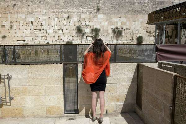 A tourist in April 2016 at the Western Wall in Jerusalem. An April survey of 1,000 U.S adults by Shelton, Conn.-based SSI found Israel remains the tourist destination perceived as the most dangerous, ahead of Egypt, North Africa and Europe.