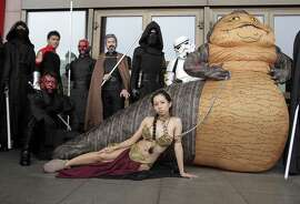 Fans dressed as movie Star Wars characters to cerebrate on the Star Wars Day in Taipei, Taiwan, Wednesday, May 4, 2016. (AP Photo/Chiang Ying-ying)