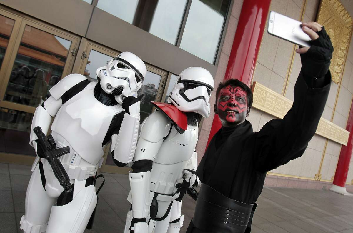 Fans dressed as movie Star Wars characters and take photos to cerebrate on the Star Wars Day in Taipei, Taiwan, Wednesday, May 4, 2016. (AP Photo/Chiang Ying-ying)