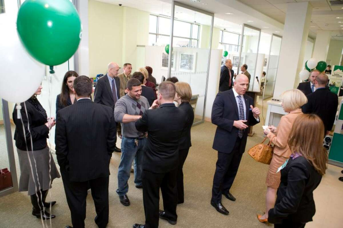 Paul Ellner, senior vice president and director of Retail Banking, RI/CT, third from right, talks with guests at the grand opening of Citizens Bank on Greenwich Avenue in Greenwich, Conn. on April 16, 2010.