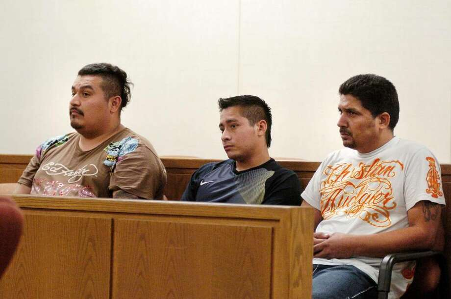 Three California men, from left, Alexander Fuentes-Martinez, Manuel Espana-Martinez and Julio Osorio-Guerra, charged with burglarizing a Greenwich jewelry store opted Friday to take their cases to trial after failing to reach a deal with prosecutors. The men, shown in this file photo being arraigned in September 2009, are also charged in a Norwalk burglary that helped Greenwich police crack the case. Photo: File Photo / Greenwich Time File Photo