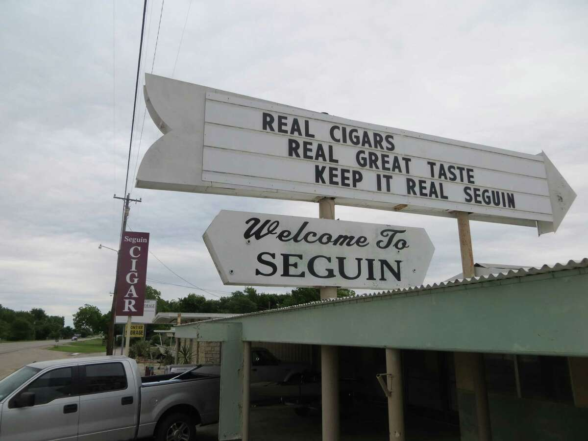 Cigar store owners Lisa and D.L. Schraub quickly incorporated Seguin's new slogan,