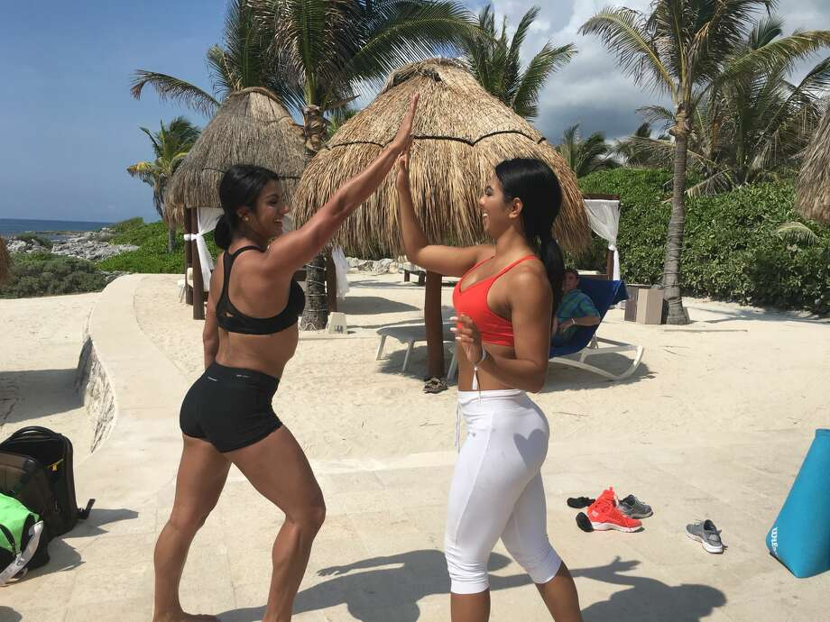 Ashley Gonzales and Chasity Morales demonstrate beach workouts in Solidaridad, Mexico on April 23, 2016. Click on to see some of their tips for getting in beach-ready shape. Photo: Madalyn Mendoza