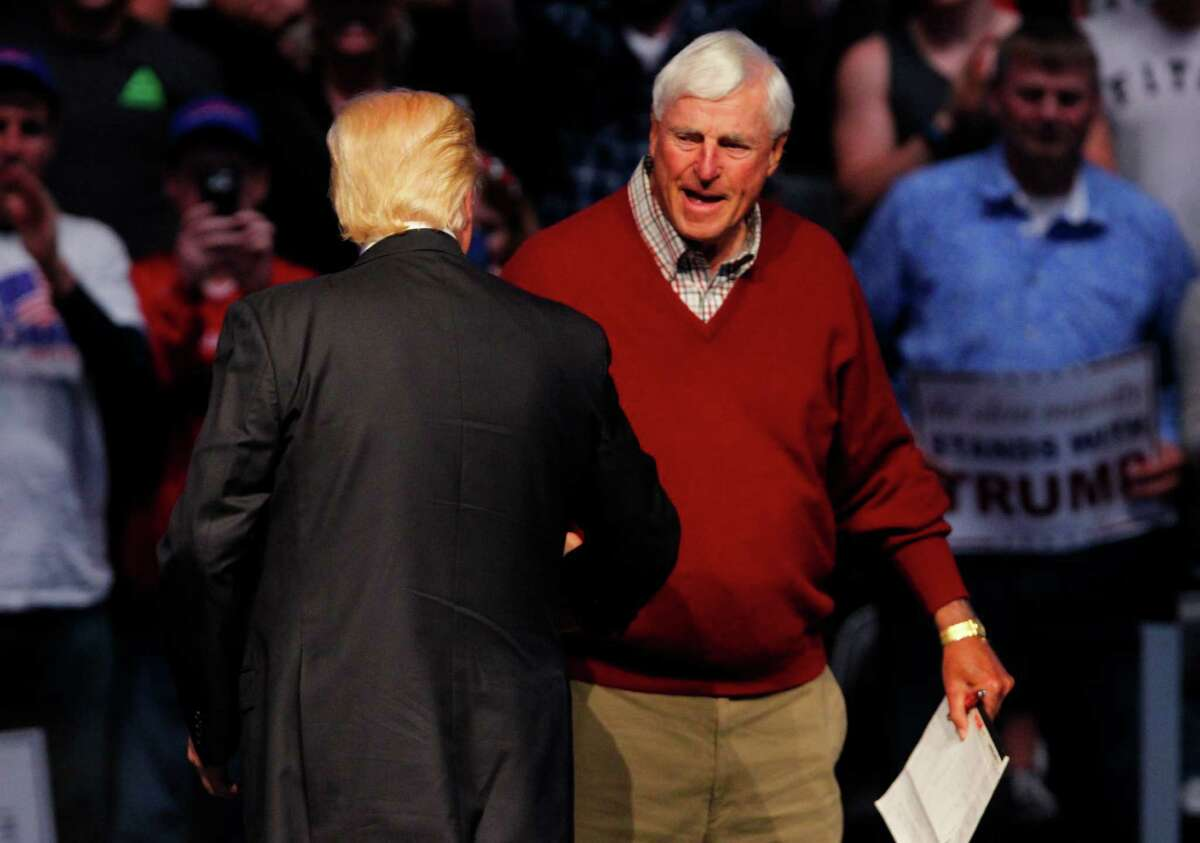 INDIANAPOLIS, IN - APRIL 27: Republican presidential candidate Donald Trump shakes hands with former Indiana University basketball coach Bobby Knight during a campaign rally at the Indiana Farmers Coliseum on April 27, 2016 in Indianapolis, Indiana. Trump is preparing for the Indiana Primary on May 3rd.