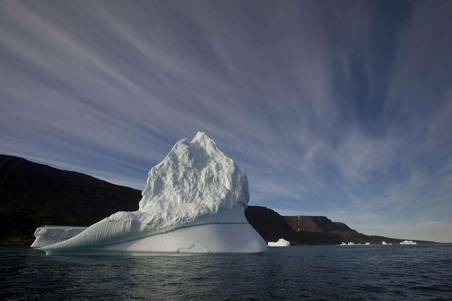 Melting iceberg in Greenland Photo: Brennan Linsley, AP