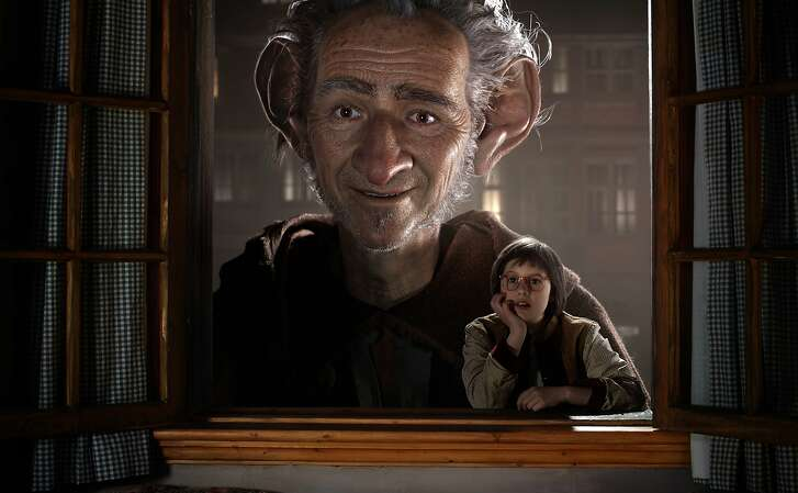 """In this image released by Disney, Ruby Barnhill portraying Sophie, right, appears in a scene with the Big Friendly Giant, voiced by Mark Rylance in """"The BFG,"""" opening nationwide on July 1. (Disney via AP)"""