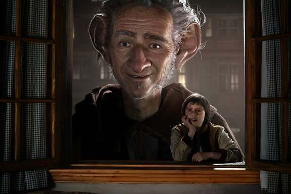 "In this image released by Disney, Ruby Barnhill portraying Sophie, right, appears in a scene with the Big Friendly Giant, voiced by Mark Rylance in ""The BFG,"" opening nationwide on July 1. (Disney via AP)"
