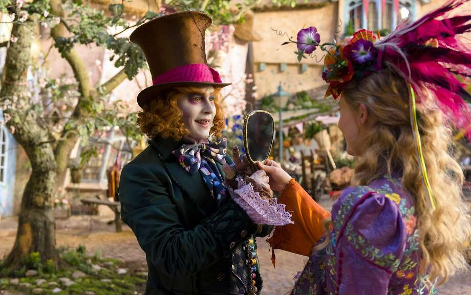 "Johnny Depp is an oddly disconnected the Mad Hatter, with Mia Wasikowska as a full-grown Alice, in an unhappy attempt at ""Alice Through the Looking Glass."" Photo: Peter Mountain, Associated Press"