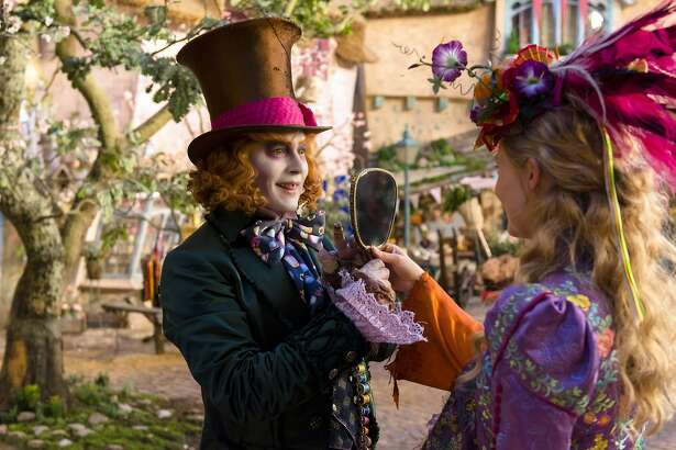"""This image released by Disney shows Johnny Depp as the Mad Hatter, left, and Mia Wasikowska as Alice in a scene from """"Alice Through the Looking Glass,"""" premiering in US theaters on May 27. (Peter Mountain/Disney via AP)"""