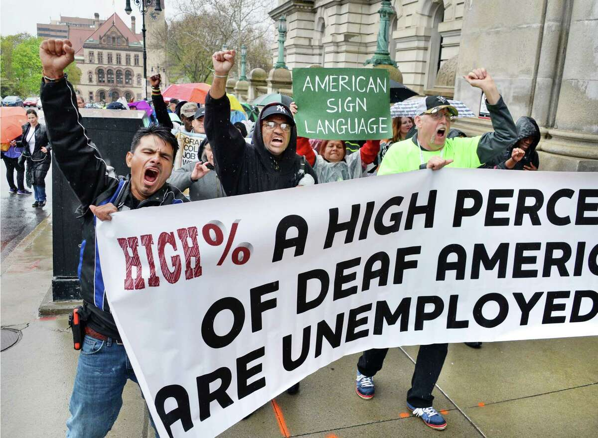 Members of Deaf Grassroots Movement march around the Capitol as they demonstrate for equal rights Wednesday May 4, 2016 in Albany, NY. (John Carl D'Annibale / Times Union)