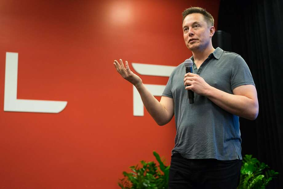 Tesla CEO Elon Musk addresses the press at Tesla Headquarters in Palo Alto, Calif. on Wednesday, Oct. 14, 2015. An update to Tesla's Autopilot system will aide drivers in changing lanes, parking and steering. Photo: James Tensuan