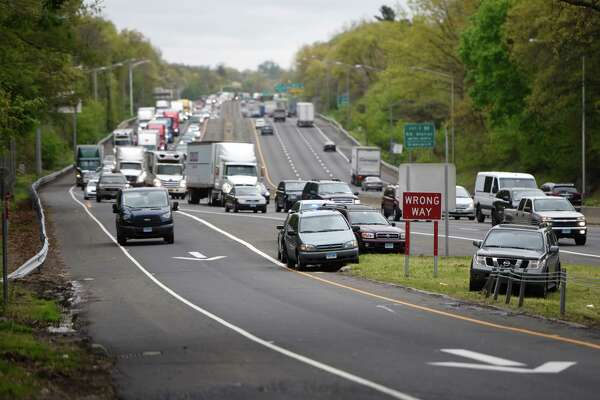 Traffic is backed up for miles as Exit 2 on I-95 is reopened after a high-speed pursuit starting in Bridgeport ended on the highway exit ramp in the Byram section of Greenwich, Conn. Wednesday, May 4, 2016.