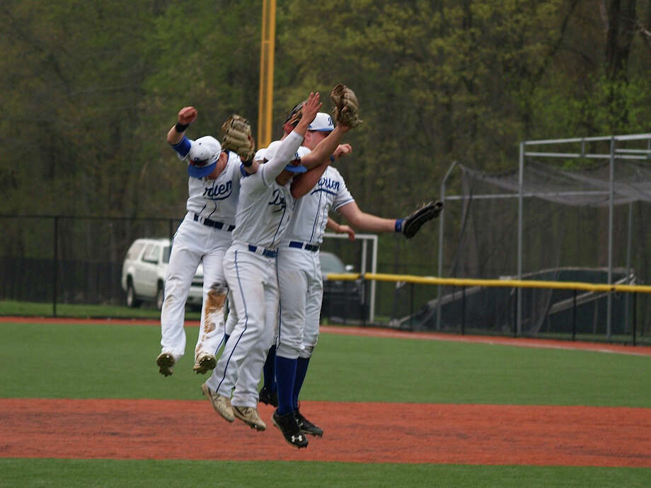 Darien infielders celebrate after defeating Wilton 8-2 Monday afternoon at Darien High School. Photo: Contributed / Darien News