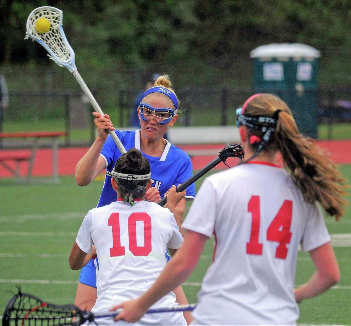 Darien's Katherine Cronin scores while defended by Greenwich's Romy Villemure and Kathryn Harford