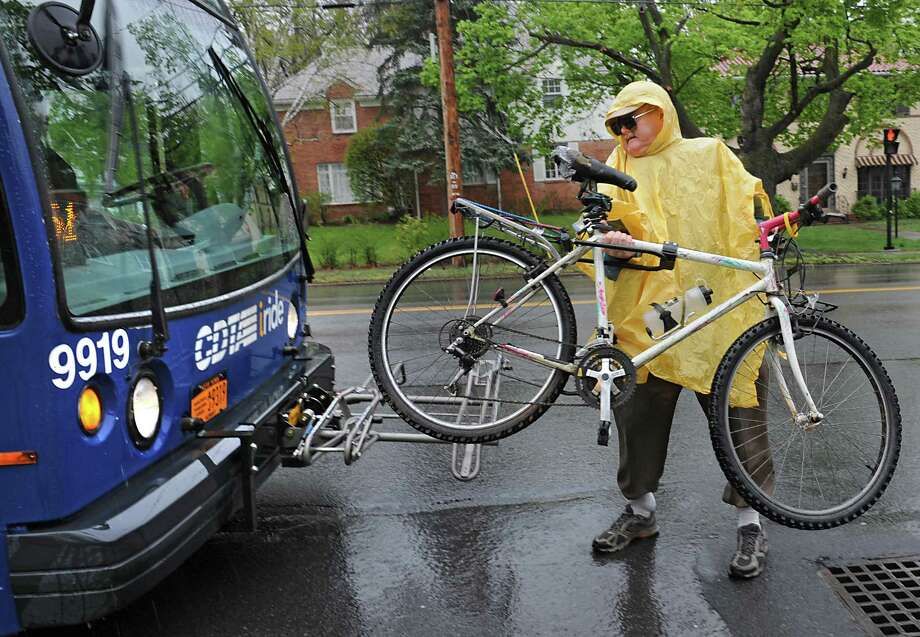 David Benkart of Albany loads his bike on the front of a CDTA bus at at bus stop on Western Ave. Wednesday, May 4, 2016 in Albany N.Y. Benkart was on his way to Rensselaer Polytechnic Institute in Troy. (Lori Van Buren / Times Union) Photo: Lori Van Buren