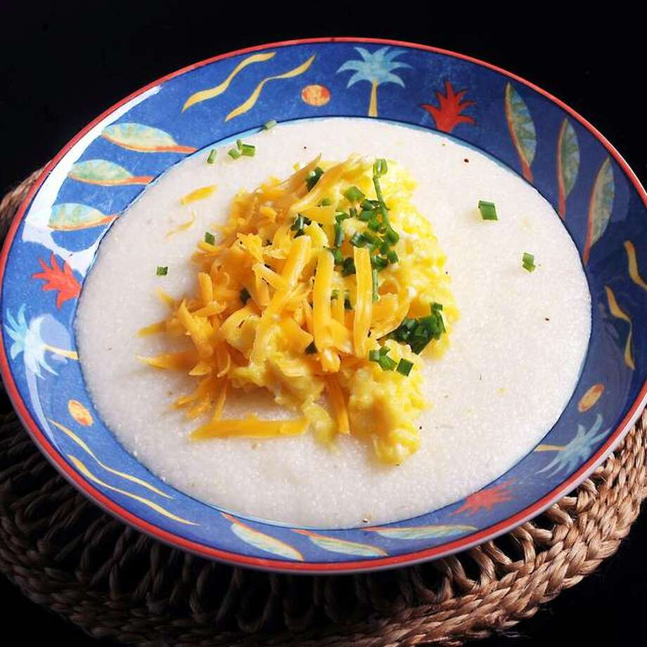 Grits with cheddar, chives and scrambled eggs are a fresh take on a classic Southern breakfast staple. (Nate Guidry/Pittsburgh Post-Gazette/TNS)
