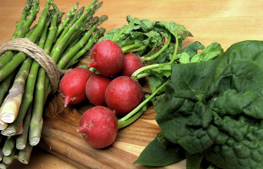 Asparagus, radish and Spinach is seen on a kitchen countertop in Caroline Barrett's home on Monday, May 2, 2016 in Delmar, N.Y. (Lori Van Buren / Times Union) Photo: Lori Van Buren / 10036202A